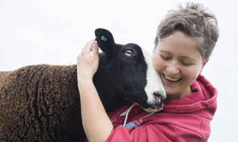 Producer with sheep in Scotland